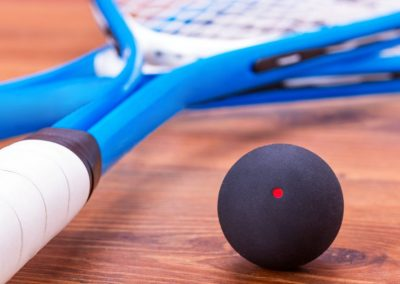 Close up of a squash rackets and balls
